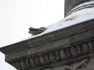 Alligator peeking out from the snow on Nelson's Column in Montreal, 2015
